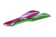 Pink&green-Kamm lokalisiert Stockfotos