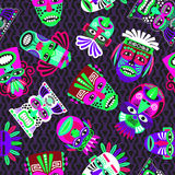 Pink and green masks on dark, seamless pattern. Pink and green masks on the dark background, seamless pattern with tribal geometric elements, vector illustration Stock Image