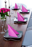 Pink and green modern serving. Serving with pink napkins and matching flower Stock Photo