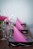 Pink and green modern serving. Serving with pink napkins and matching flower Stock Photography