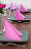 Pink and green modern serving. Serving with pink napkins and matching flower Royalty Free Stock Image