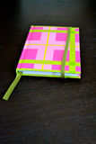 Pink and Green Notebook Stock Image
