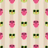 Pink and green owls on striped background seamless pattern Royalty Free Stock Photography