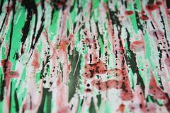 Pink green phosphorescent black waxy drips paint. Watercolor paint abstract background. Black green pink black phosphorescent  purple wax hypnotic dark romantic Royalty Free Stock Image