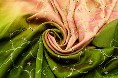 Pink and green satin textile Stock Images