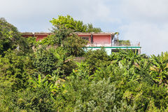 Pink and Green Stucco Home on Tropical Hill Stock Photo
