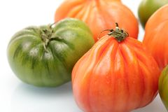Pink and green tomatoes Stock Photos
