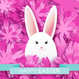 Pink Greeting card with Happy Easter - with white Easter rabbit. Stock Photo