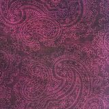 Pink and grey paisley patterned background. A dark grey shabby background covered in fancy pink paisley shapes Stock Images