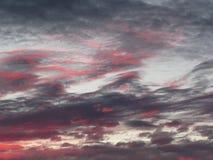 Pink and Grey Sunset Cloud Drama Royalty Free Stock Image