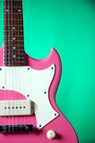 Pink Guitar Isolated On Green Royalty Free Stock Image