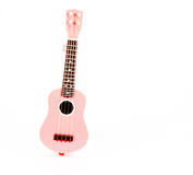 Pink guitar toy isolated on white background Royalty Free Stock Images