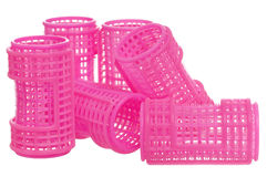 Pink hair curlers Stock Photography