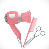 Pink hair dryer with concentrator, scissors and comb Stock Photo