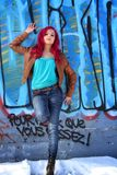 Pink hair girl against a blue wall Stock Photos