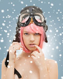 Pink hair girl in aviator helmet with snow Stock Photography