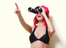 Pink hair girl in bikini with cap and binoculars royalty free stock images