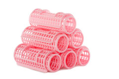 Pink hair rollers. A stack of pink hair rollers isolated over white Royalty Free Stock Photos