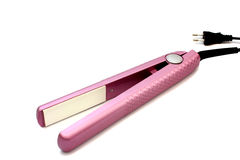 Pink hair straighteners Royalty Free Stock Image