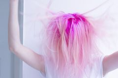 Pink hair woman is roughing her hair, feeling crazy royalty free stock images