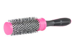 Pink hairbrush. Over a white background Royalty Free Stock Image