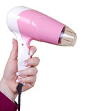 Pink hairdryer in hand Royalty Free Stock Photos