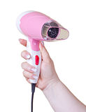 Pink hairdryer in hand Stock Photo