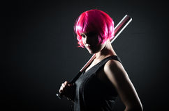 Pink haired girl with bat Royalty Free Stock Photos