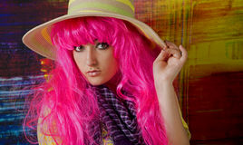Pink haired girl tips her sun hat Royalty Free Stock Images