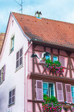 Pink half timbered house in alsace Royalty Free Stock Photography