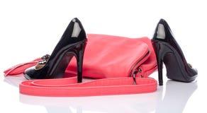 Pink handbag and black high heel shoes Royalty Free Stock Photos