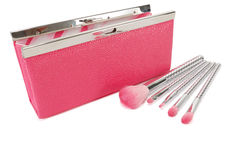 Pink handbag and cosmetic brushes Stock Photos