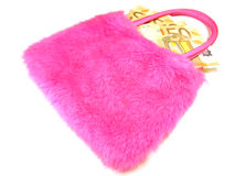 Pink handbag with money. Pink isolated handbag with money on the white background Royalty Free Stock Photo