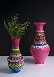 Pink handcrafted pottery vases and green branches with harsh shadow Stock Photo