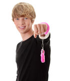 Pink handcuff. Young caucasian man with pink handcuff Royalty Free Stock Photography