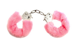 Pink handcuffs. Pink soft handcuffs isolated on white Royalty Free Stock Photography