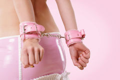 Pink handcuffs Stock Photo