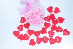 Pink handmade decoration for wedding celebration with heap of red hearts for valentine day stock photos