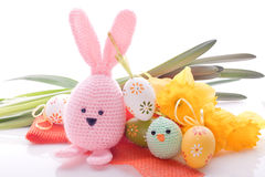 Bunny with easter eggs and spring flowers. Pink handmade easter bunny with easter eggs and spring flowers Royalty Free Stock Image
