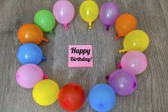 Pink Happy Birthday Card with Balloons. Pink Happy Birthday Card with Colorful Balloon Frame on a Wooden Background royalty free stock photos