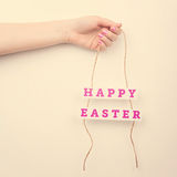 Pink Happy Easter text sign on a rope Royalty Free Stock Image