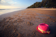 Pink hat on beach Stock Images
