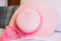 Pink hat on couch Royalty Free Stock Photography