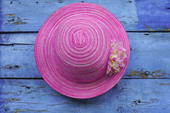 Pink hat hanging on wooden wall Stock Photography