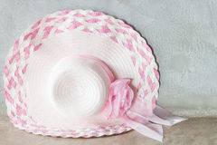 Pink hat with ribbon on grey background Royalty Free Stock Photos