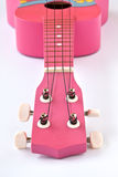 Pink Hawaiian ukulele Stock Photography