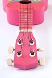 Pink Hawaiian ukulele. Closeupshot of a Pink Hawaiian ukulele on white background Stock Photography