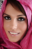 Pink head wear. Female model wearing a head scarf which is bright pink looking directly at the camera smiling Royalty Free Stock Photo