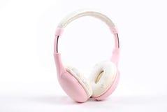 Pink headphone. On white background Stock Photos