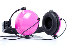 Pink headphones. On white Royalty Free Stock Images